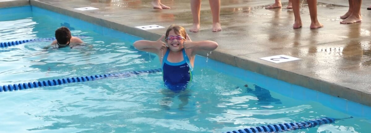 Olmsted Falls swim team member gives thumbs up
